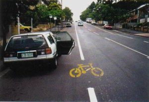 "This ""bicycle awareness zone"" positions a passing bike outside the car door zone (c/ Michael Yeates)"