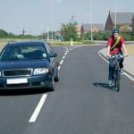 That's right, use the other lane to pass (c/ UK Road Cycling Laws)
